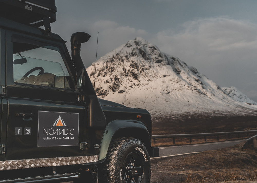 Nomadic Scotland Land Rover in the mountains of Scotland